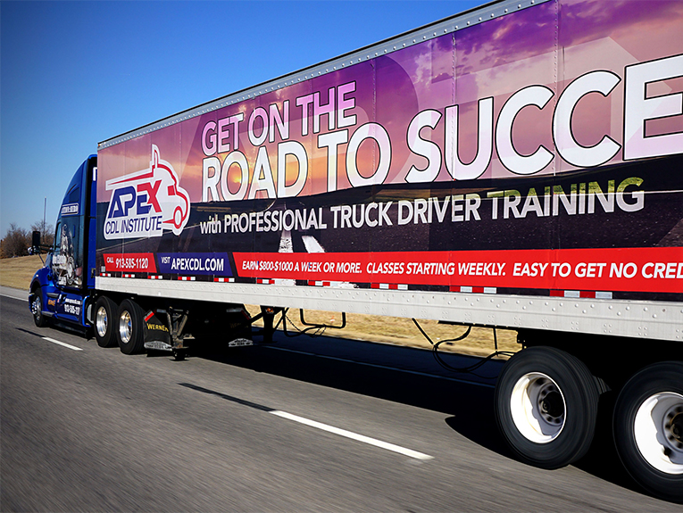 Apex truck and trailer driving on road