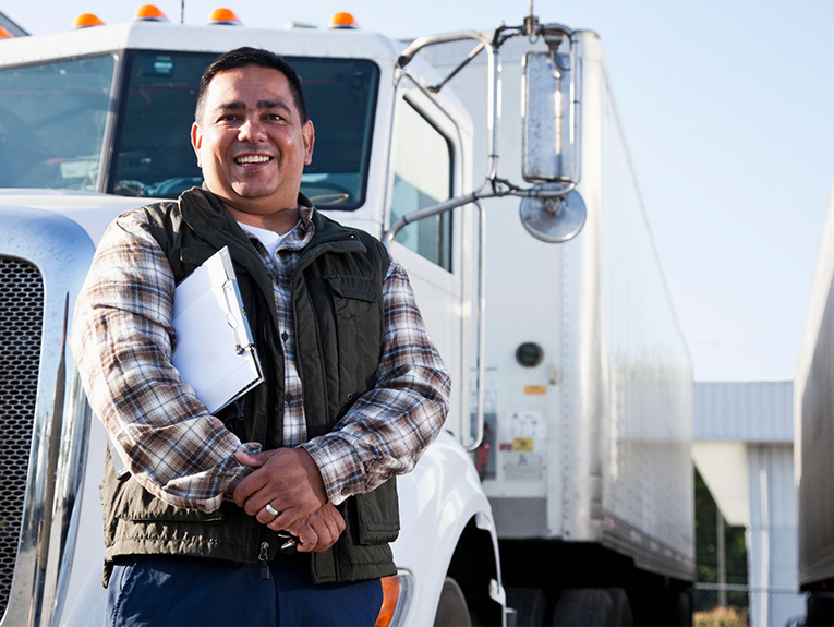 driver smiling in front of truck