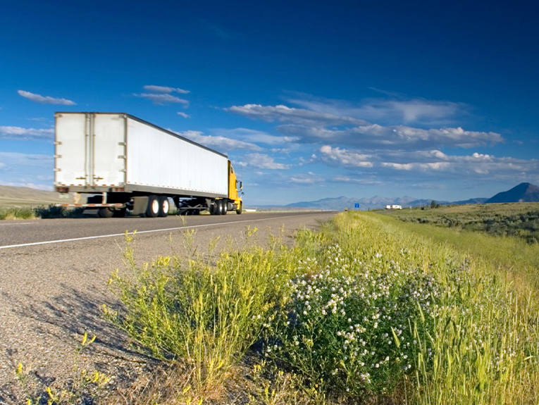 truck driving on road alone