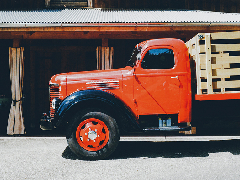 old red truck in front of store