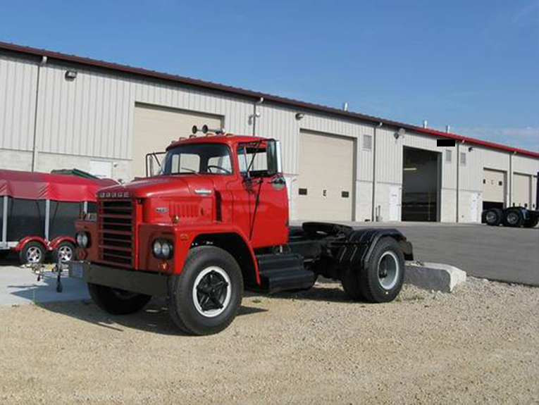 Red semi truck from the 1960s, no cargo attached