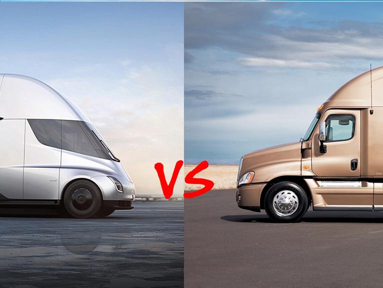 The tesla semi truck is facing an older model semi truck