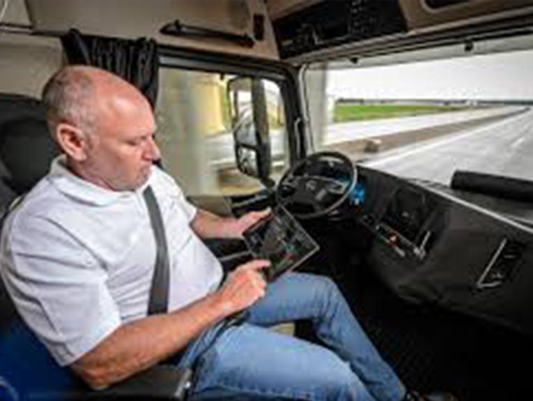 Man sitting inside semi truck