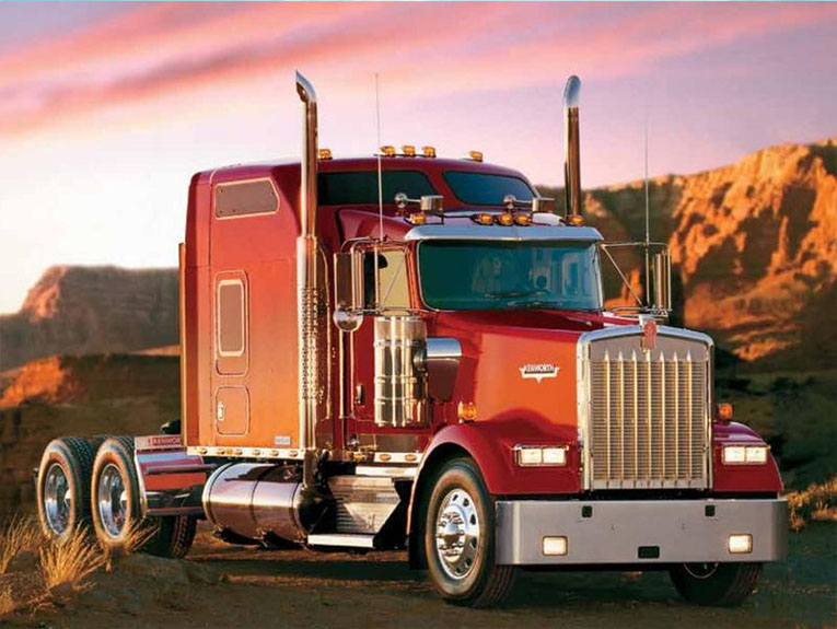 Red truck in front of sunset