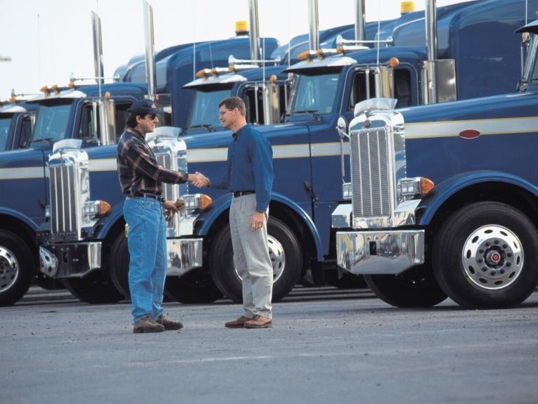 Truck Driver Shaking Hands
