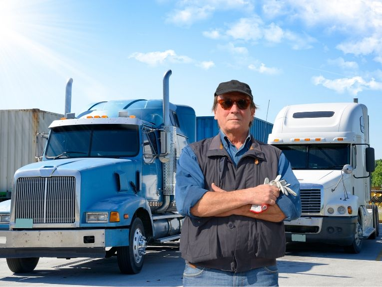 Man standing next to trucks