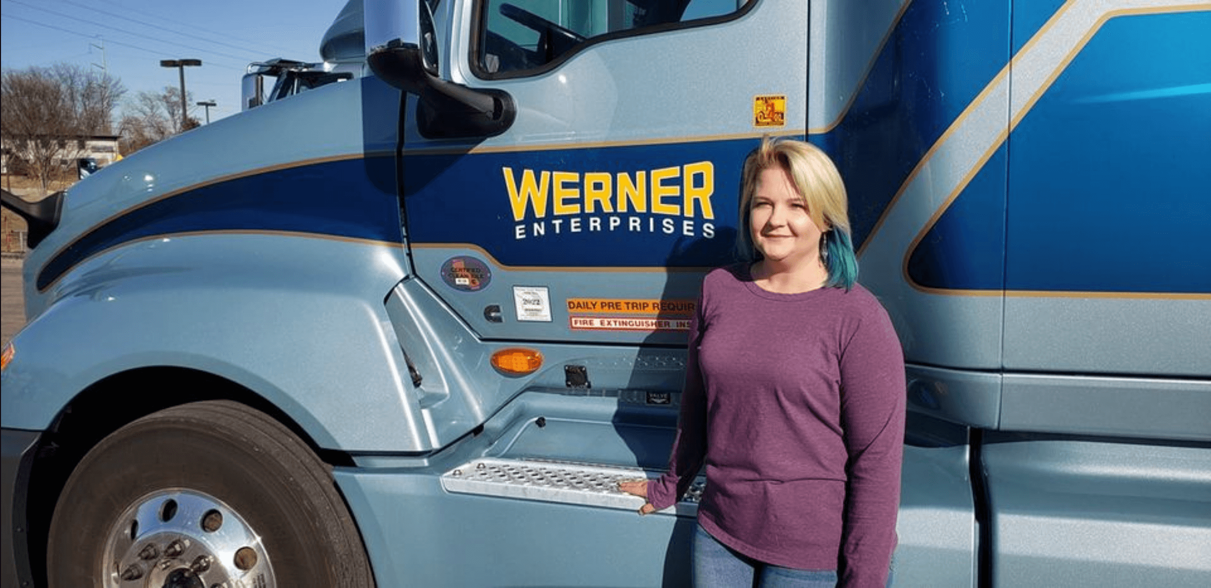 Apex student standing in front of her Werner truck