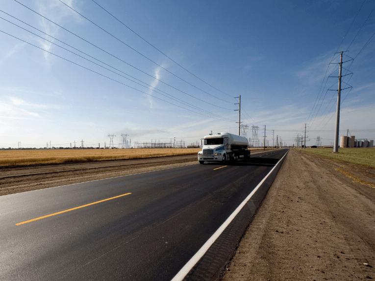 White Truck Driving Through Plains