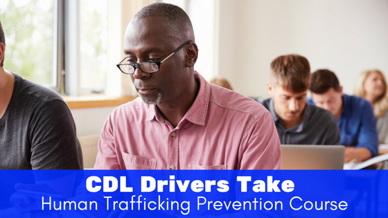 people studying with laptops in a classroom - cdl drivers take human trafficking prevention course