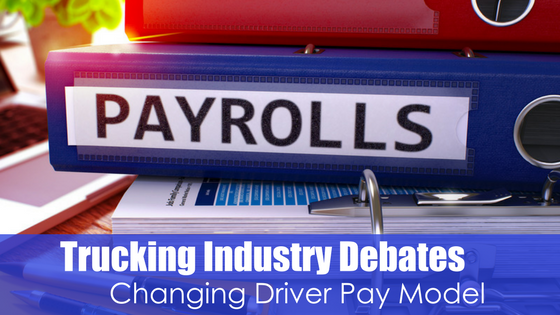 binder with Payrolls written on spine with text trucking industry debates changing driver pay model