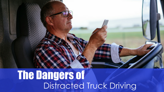 man trying to text and drive with text the dangers of distracted truck driving
